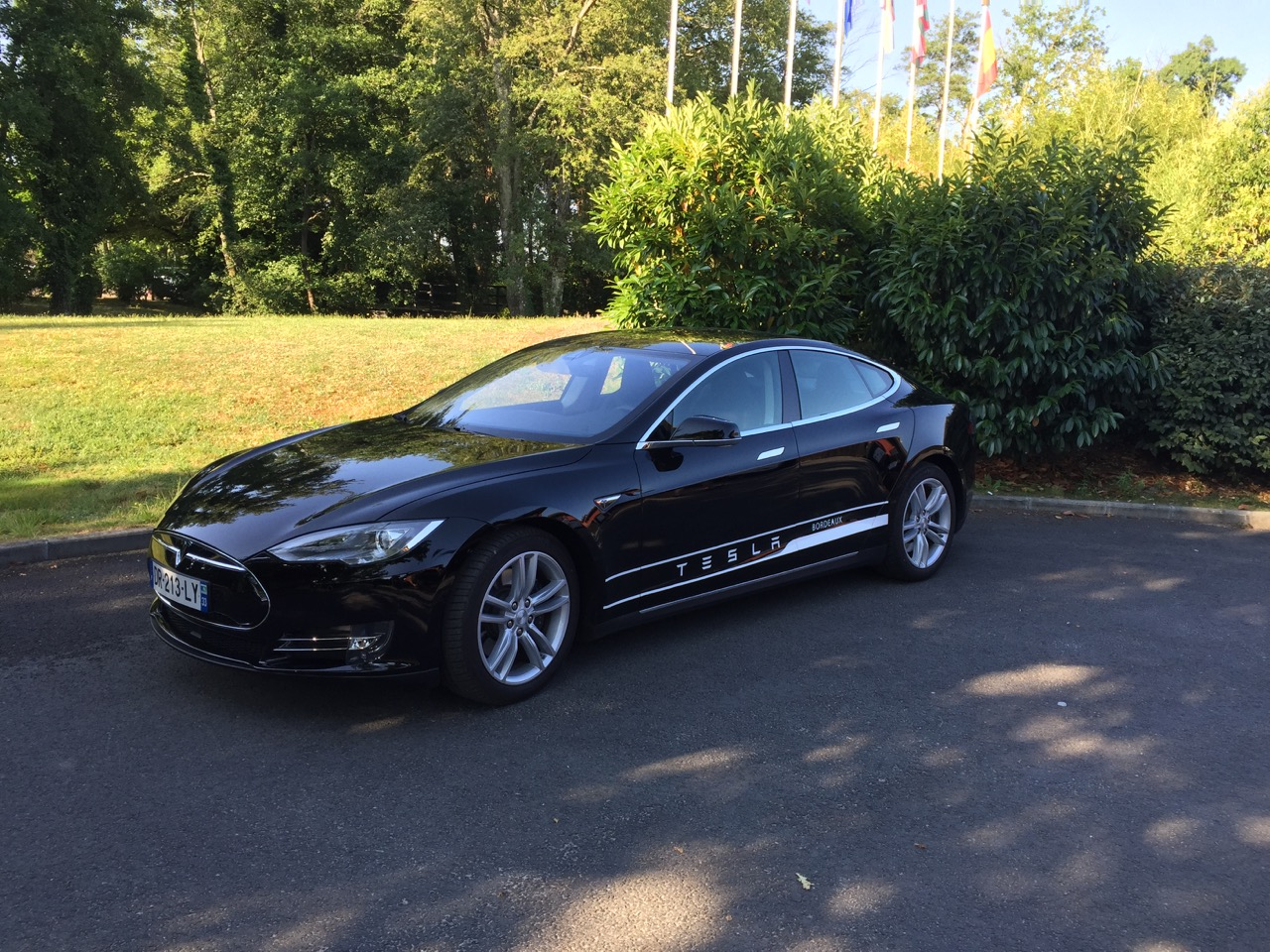 Test driving a Tesla at Golf du Medoc, France