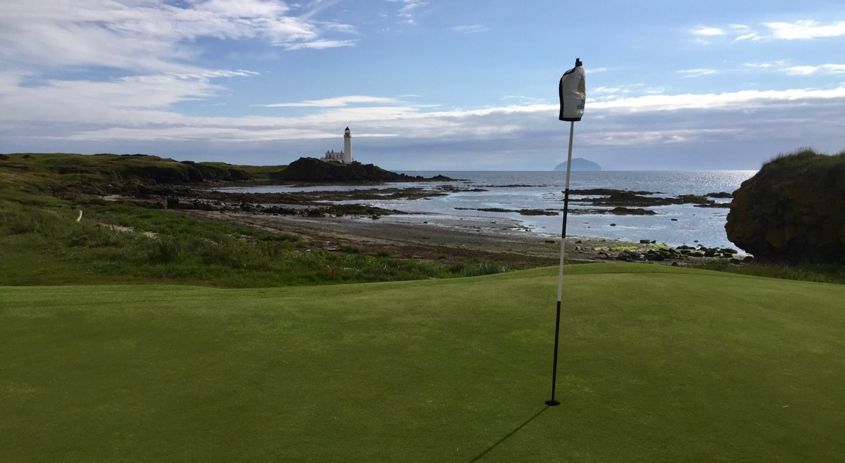 TurnberryResort 10th green with lighthouse Ailsa Craig in background